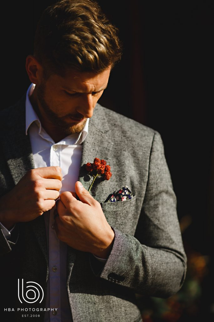 Gorgeous groom with bramble buttonhole
