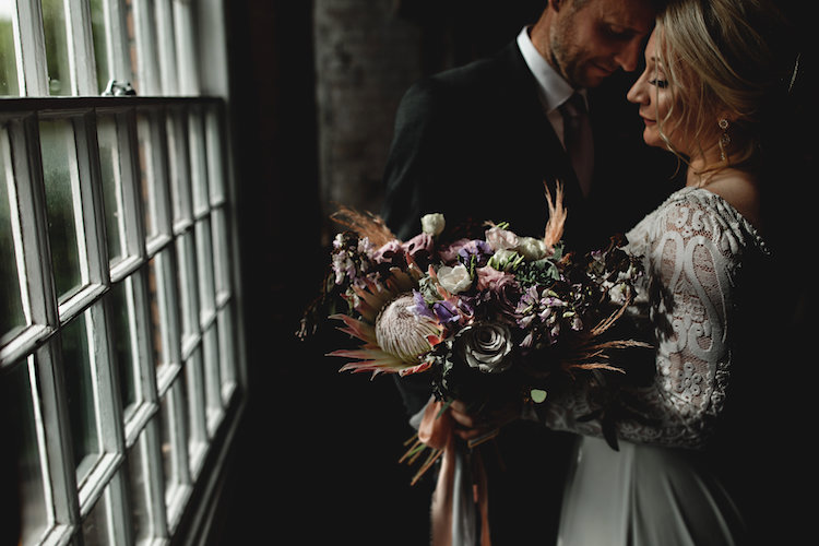 Couple with a bouquet and window